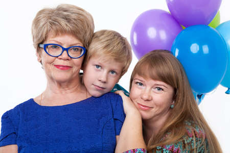 mature old generation: Three people portrait with senior grandma, adult mother and young child on white background Stock Photo