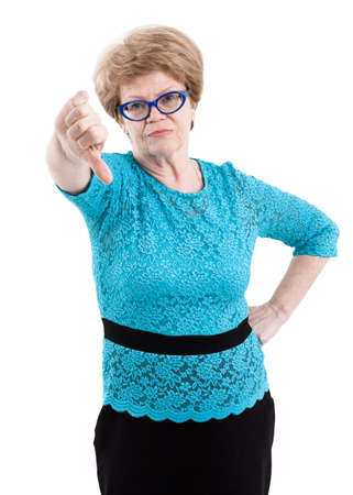 only women: Indifferent elderly woman showing thumbs down, isolated on white background