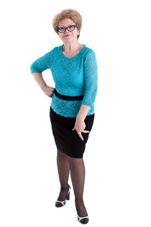 wrinkled: Satisfied senior Caucasian woman posing in black skirt and blue blouse in full length, isolated on white background