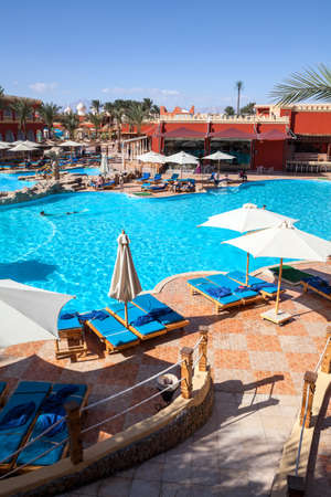 alf: HURGHADA, EGYPT - CIRCA NOV, 2015: Poolside is in the Egyptian hotel. Swimming pool with blue water. The Alf Leila Wa Leila spa (1001 Nights) is one of the Pickalbatros Editorial