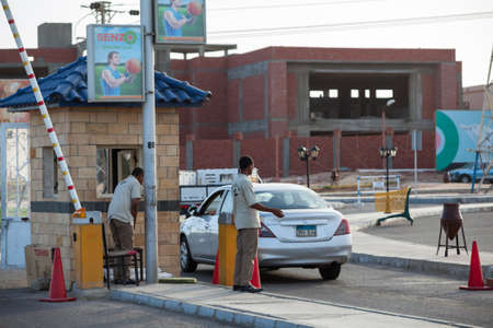 barrier: HURGHADA, EGYPT - CIRCA NOV, 2015: The checkpoint with barrier and guards is on the Senzo Mall parking lot. Safety precautions are in public places in Egypt Editorial