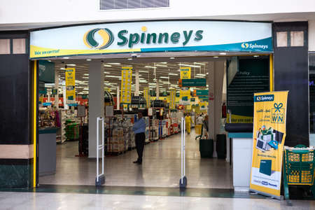 general store: HURGHADA, EGYPT - CIRCA NOV, 2015: Entrance in the one of the Spinneys supermarket chain is in the Senzo Shopping Mall. The Spinneys Group Limited has three grocery stores in Egypt Editorial