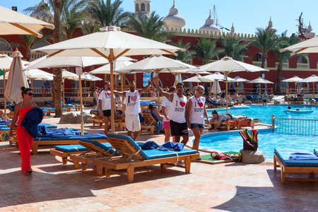 alf: HURGHADA, EGYPT - CIRCA NOV, 2015: Recreational multiethnic animation team makes fun in hotel area. The Alf Leila Wa Leila spa (1001 Nights) is one of the Pickalbatros chain spas in Hurgada resort