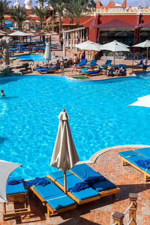 alf: HURGHADA, EGYPT - CIRCA NOV, 2015: Swimming pool is in the Egyptian four stars hotel. The Alf Leila Wa Leila spa (1001 Nights) is one of the Pickalbatros Editorial