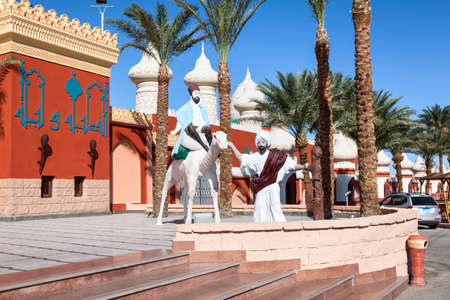 alf: HURGHADA, EGYPT - CIRCA NOV, 2015: Sculptures of bedouins with camel are near the Egyptian hotel. The Alf Leila Wa Leila spa (1001 Nights) is one of the Pickalbatros chain spas in Hurgada resort Editorial