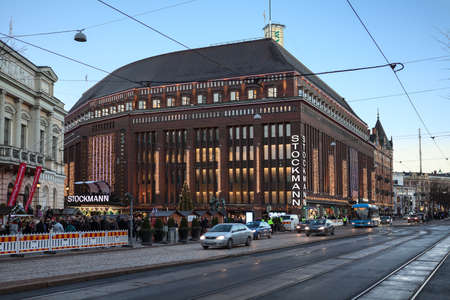 city centre: HELSINKI, FINLAND - CIRCA DEC, 2015: The Stockmann shopping center building is on the Mannerheimintie at evening. Stockmann is the largest fashion mall in Scandinavia