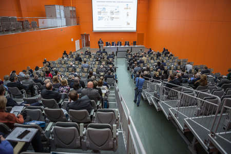 exposition: MOSCOW, RUSSIA - CIRCA NOV, 2015: People sit on the scientific and technical seminar in the hall of the Metal-Expo'2015, the 21st International Industrial Exhibition in the All-Russia Exhibition Center Editorial