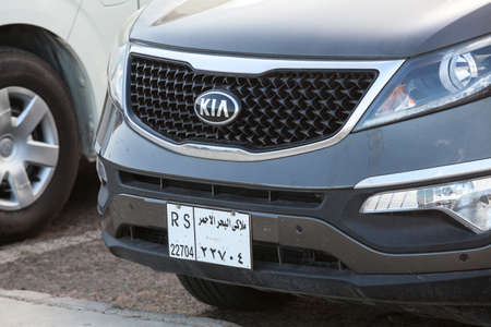 front bumper: HURGHADA, EGYPT - CIRCA NOV, 2015: Vehicle register number is on the front bumper of Kia. Egyptian license-plate numbers are on the cars Editorial