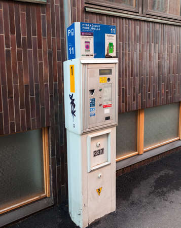 pay for: HELSINKI, FINLAND - CIRCA, DEC, 2015: Automatic device to pay for parking is on the each street of city. Ticket box for fee paying