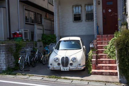 kanagawa: KAMAKURA, JAPAN-Circa APR, 2013: The yard of the private townhouse with a parked car is on the outskirts of Kamakura. The Kamakura is a old city in Kanagawa Prefecture