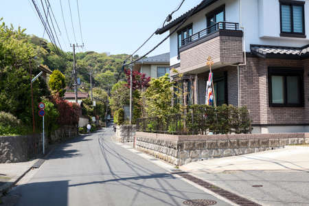 kanagawa: KAMAKURA, JAPAN-Circa APR, 2013: Street with dwelling houses is at the outskirts of Kamakura. The Kamakura is a old city in Kanagawa Prefecture