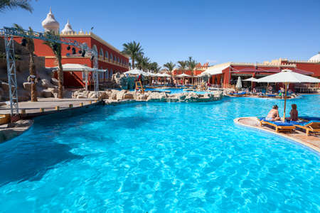 alf: HURGHADA, EGYPT - CIRCA NOV, 2015: Swimming pool and poolside are in the Egyptian hotel. The Alf Leila Wa Leila spa (1001 Nights) is one of the Pickalbatros