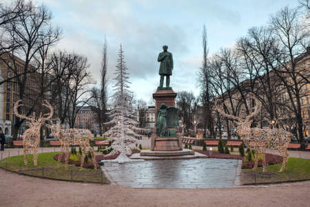 finnish: HELSINKI, FINLAND - CIRCA, DEC, 2015: Statue of Walter Magnus Runeberg a Finnish neo-classical sculptor. Located on the square of Esplanadi park in centre of city Editorial
