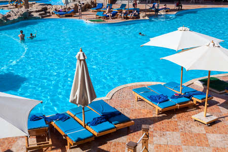 alf: HURGHADA, EGYPT - CIRCA NOV, 2015: Swimming pool with people is in the Egyptian four stars hotel. The Alf Leila Wa Leila spa (1001 Nights) is one of the Pickalbatros