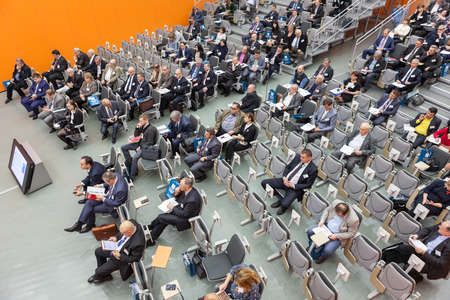 large: MOSCOW, RUSSIA - CIRCA NOV, 2015: Visitors sit on the seminar in the hall of the Metal-Expo'2015, the 21st International Industrial Exhibition in the All-Russia Exhibition Center (VDNH) Editorial