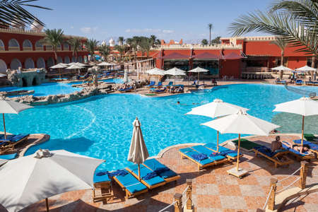 hurghada: HURGHADA, EGYPT - CIRCA NOV, 2015: People sunbath in the Egyptian hotel. The Alf Leila Wa Leila spa (1001 Nights) is one of the Pickalbatros Editorial
