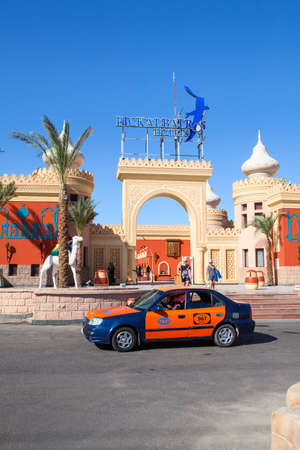 alf: HURGHADA, EGYPT - CIRCA NOV, 2015: Egyptian taxi car stands on hotel drop off zone. The Alf Leila Wa Leila spa (1001 Nights) is one of the Pickalbatros chain spas in Hurgada resort