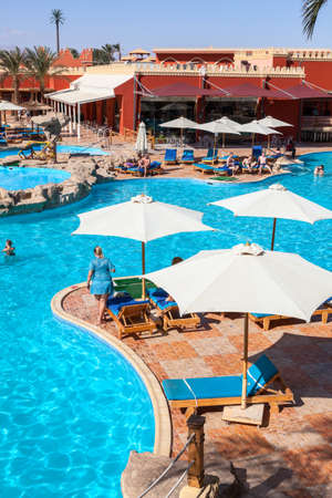 alf: HURGHADA, EGYPT - CIRCA NOV, 2015: Poolside with sun parasols is in the Egyptian hotel. The Alf Leila Wa Leila spa (1001 Nights) is one of the Pickalbatros Editorial