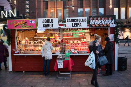 tent city: HELSINKI, FINLAND - CIRCA, DEC, 2015: Trading tent for the sale of sweets and pastries on Christmas holidays is in downtown of city. Street pavilion for the bake sale