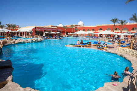 alf: HURGHADA, EGYPT - CIRCA NOV, 2015: Main swimming pool and poolside are in the Egyptian hotel. The Alf Leila Wa Leila spa (1001 Nights) is one of the Pickalbatros