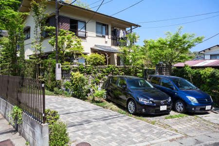 kanagawa: KAMAKURA, JAPAN-Circa APR, 2013: The yard of the house with a parked cars is on the outskirts of Kamakura. The Kamakura is a old city in Kanagawa Prefecture