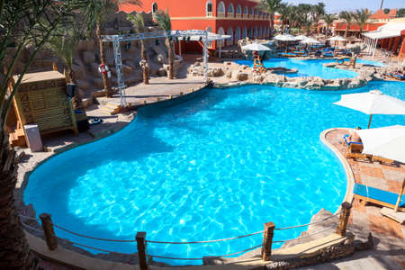 alf: HURGHADA, EGYPT - CIRCA NOV, 2015: Main deep swimming pool is on the hotel area. The Alf Leila Wa Leila spa (1001 Nights) is one of the Pickalbatros Editorial