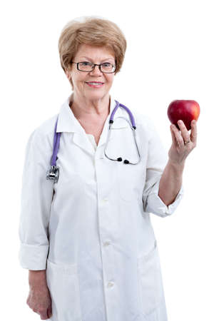dietician: An elder doctor dietician showing red big apple in hand, isolated on white background Stock Photo