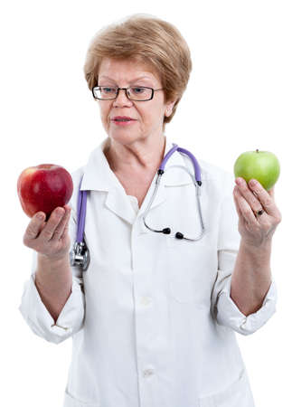 big apple: Doctor nutritionist looking at red big apple in one hand and holding green apple in other isolated on white background