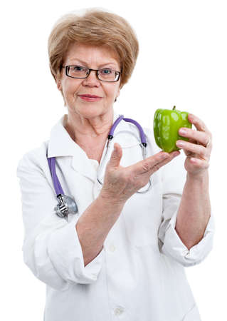 woman diet: Woman a senior doctor showing at the green sweet pepper, isolated on white background Stock Photo