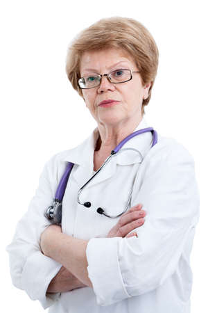 clasped: Portrait of serious mature woman in doctor uniform with clasped arms, looking at camera, isolated on white background