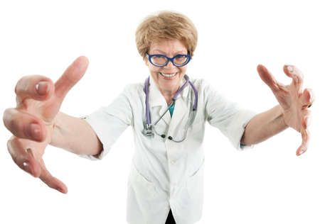 senior women: Mad senior female doctor stretching hands to camera with smile, isolated on white background Stock Photo