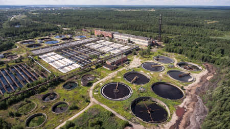 Industrial wastewater treatment plant with primary, secondary, and disinfection sequence of sewage treatment. Aerial view