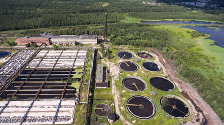 process industry: Territory of water treatment plant located in coniferous woods. Aerial view from drone Stock Photo