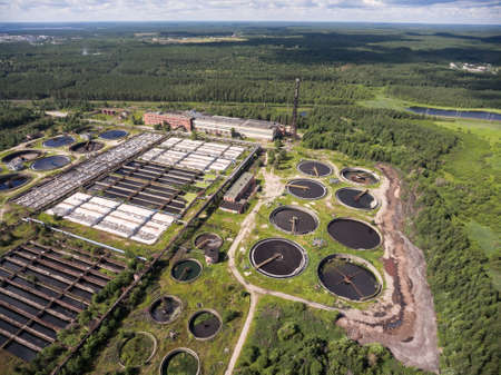 Area of water treatment plant with round settling and sedimentation tanks. Aerial view from drone Stock Photo