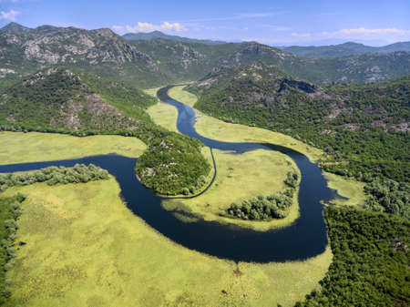 Watercourse bend of river Rjieka Crnojevica. Beauty nature in mountains. Part of Skadar lake and national park. Montenegro Stock Photo