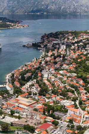 boka: Modern buildings and medieval old town are in Kotor city. Port with cruise liners are in Boka Kotorska, Montenegro