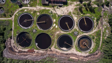 water plants: Mechanical settling tanks a clarifiers are in wastewater treatment plant. Aerial view Stock Photo