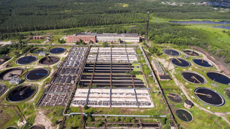 treatment plant: An industrial wastewater treatment plant located in evergreen forest and lakes