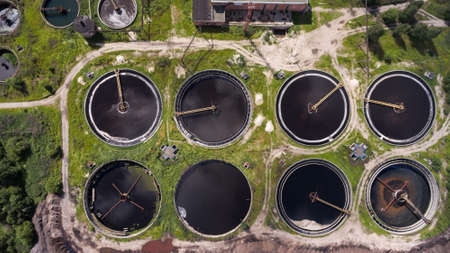 chemically: Clarifiers or settling tanks with mechanical means for continuous removal of solids in water treatment plant Stock Photo
