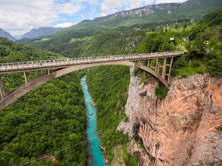 tara: Durdevica bridge is concrete arch bridge over the Tara River in northern Montenegro. Side top view from flying drone Stock Photo