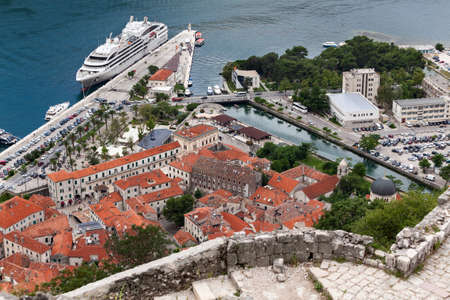 kotor: View from the stairways of walking path to St. John castle at roofs of old town of Kotor city. Montenegro Stock Photo
