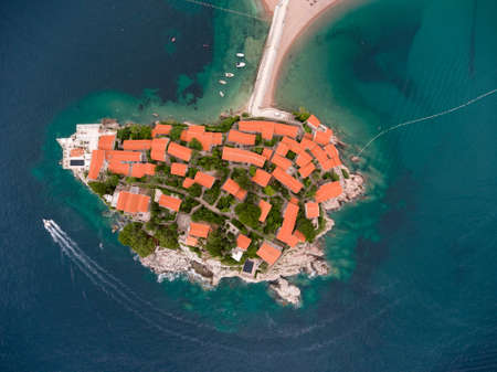 isthmus: Narrow isthmus connecting mainland with Sveti Stefan islet. Aerial view. Sveti Stefan hotel with the Villa Milocer, Montenegro