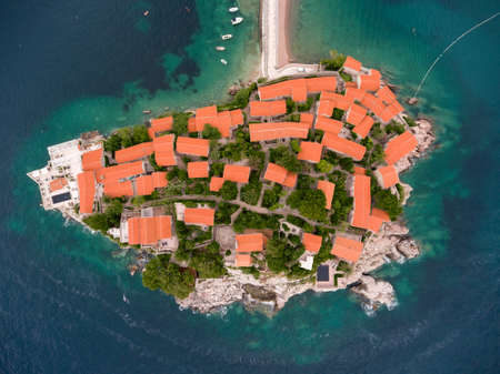sea of houses: Top view at the Sveti Stefan island and hotel resort with red roofs of houses. Adriatic sea, Montenegro, Europe Stock Photo