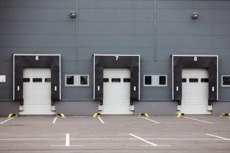 Modern truck loading bays with overhead doors. Empty area, close gates