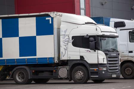 loading truck: ST. PETERSBURG, RUSSIA - CIRCA AUG, 2015: Semitruck of PEC Russian transportation company is on the loading near warehouse. Pec is Russian logistics company