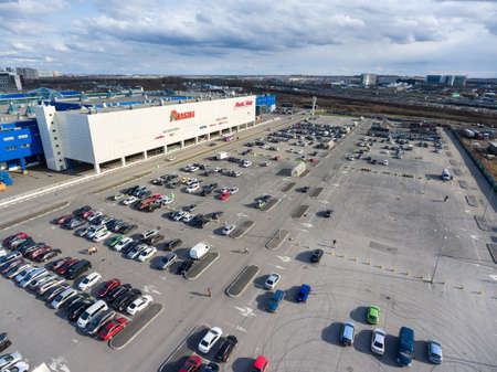 lot of: ST. PETERSBURG, RUSSIA - CIRCA APR, 2016: Shopping plaza Leto is on the Pulkovskoe highway. Additional car parking lot is on the backyard. Leto is a retail and entertainment mall