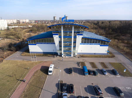 building a chain: ST. PETERSBURG, RUSSIA - CIRCA APR, 2016: The building of a sports and recreation complex of Gazprom company is on avenue (prospect) Veteranov, Kirovsky district. Chain of sport centers are in city