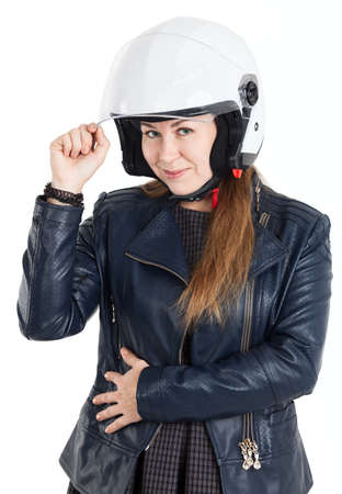 a helmet: Cheerful Caucasian woman in leather jacket and white motorcycle helmet, isolated on white background