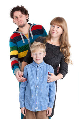 family isolated: Happy family with father, mother and son standing together, isolated on white background