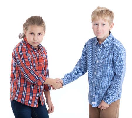 Temporary truce - children shake hands, isolated white background